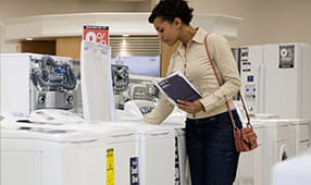 Woman Looking at a Washing Machine